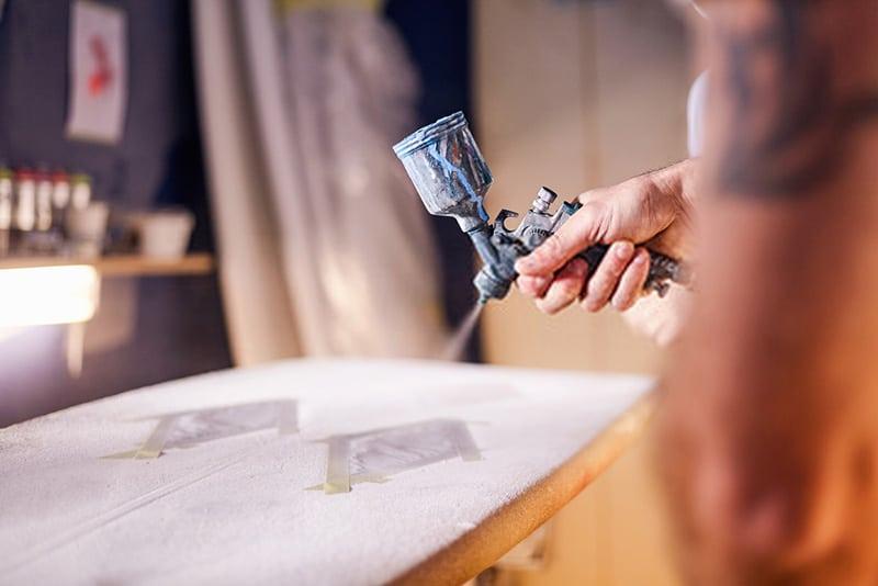 spray painting surfboard